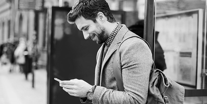 Young man on a smartphone in the city